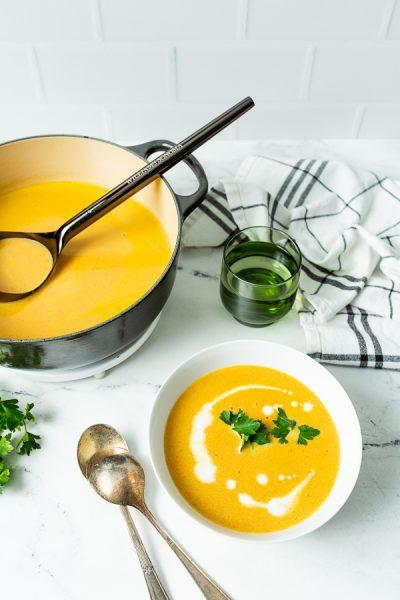 white bowl full of dutch oven carrot ginger soup