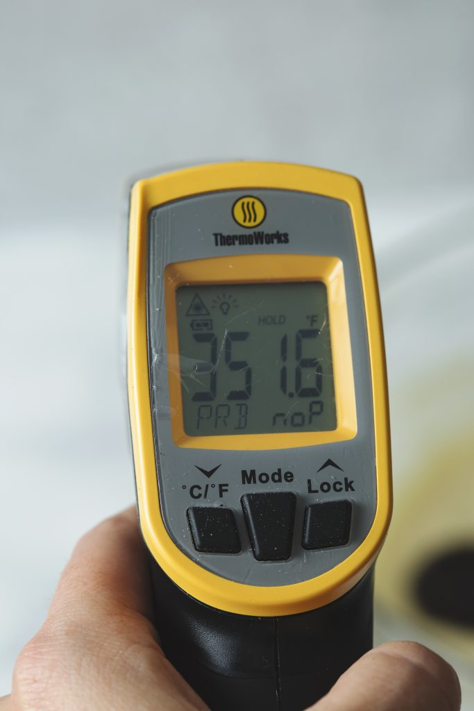 Image of a Thermoworks Infrared Thermometer displaying the temperature of 351.6 degrees F when pointed at a dutch oven of fry oil.