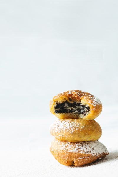 stack of three fried Oreos with bite taken out of the top one