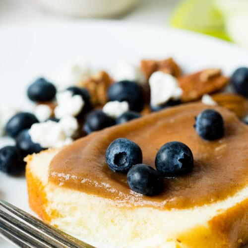 apple butter on bread with blueberries on top