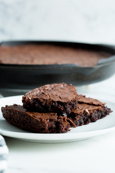 three pieces of brownie on white circle plate